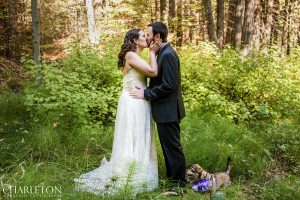 a wedding couple and their dog