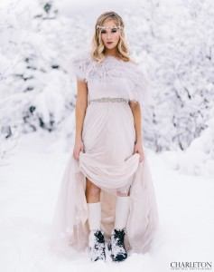 bride with hiking boots in the snow
