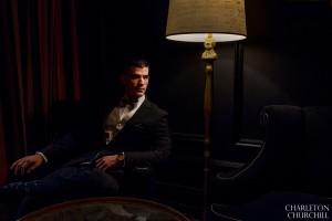groom under lamp