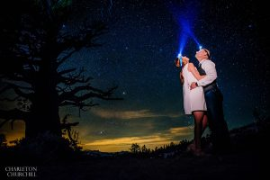 star photos with engaged couple wearing headlamps