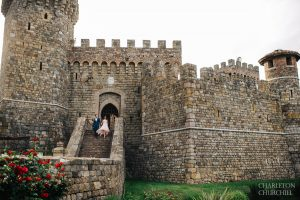 front view of the Castello on steps with fashionable couple