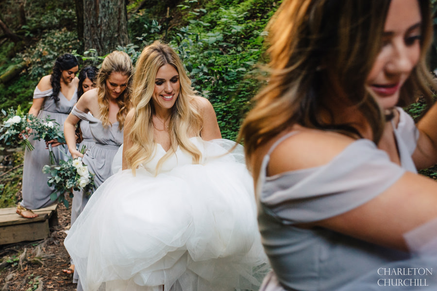 bridesmaids hiking with bride in forest