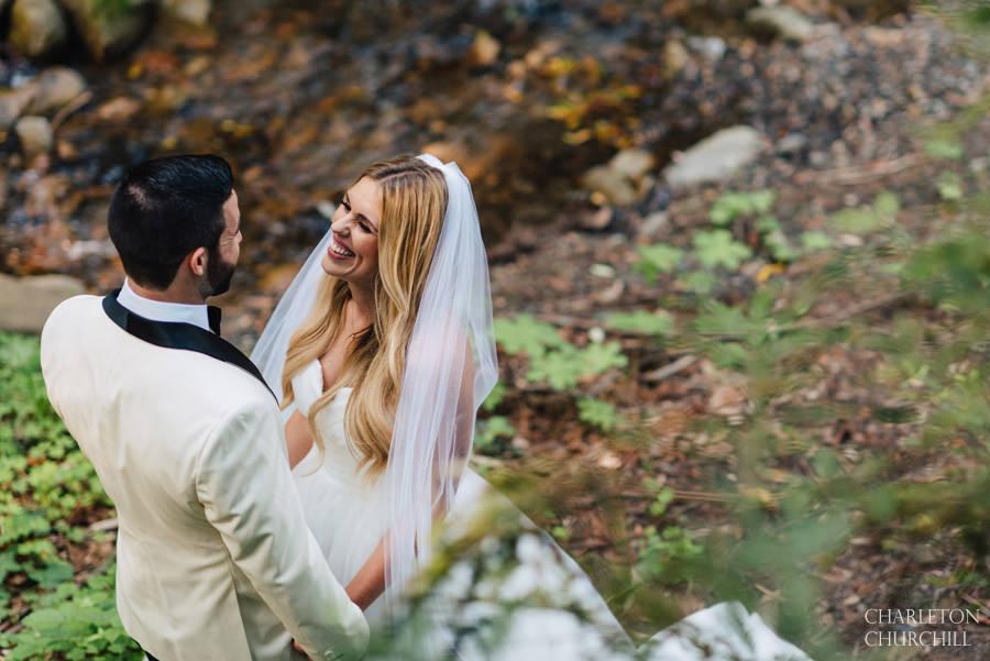 woodsy wedding first look of bride groom
