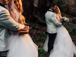 moody lighting of couple in the woodsy scene