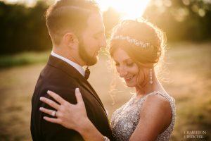 warm romantic sunset photos of wedding couple
