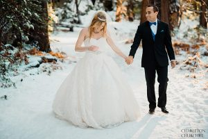 adventurous couple taking a walk in the snow