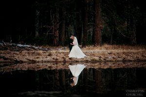 wedding couple reflected off lake