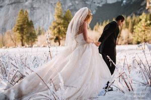 wedding couple hiking in the cold snow wilderness