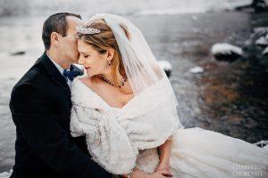wintery destination wedding with a white wrap