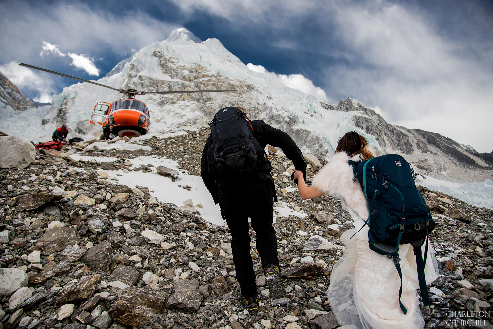 wedding couple leaving basecamp after getting married leaving on a helicopter