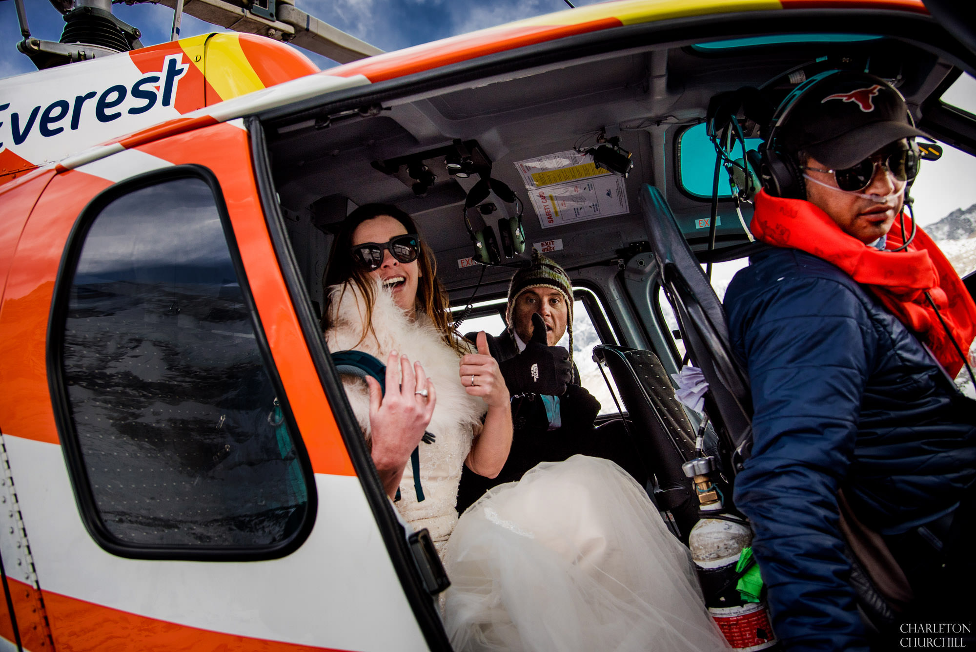 elopement photos of adventurous couple getting on helicopter