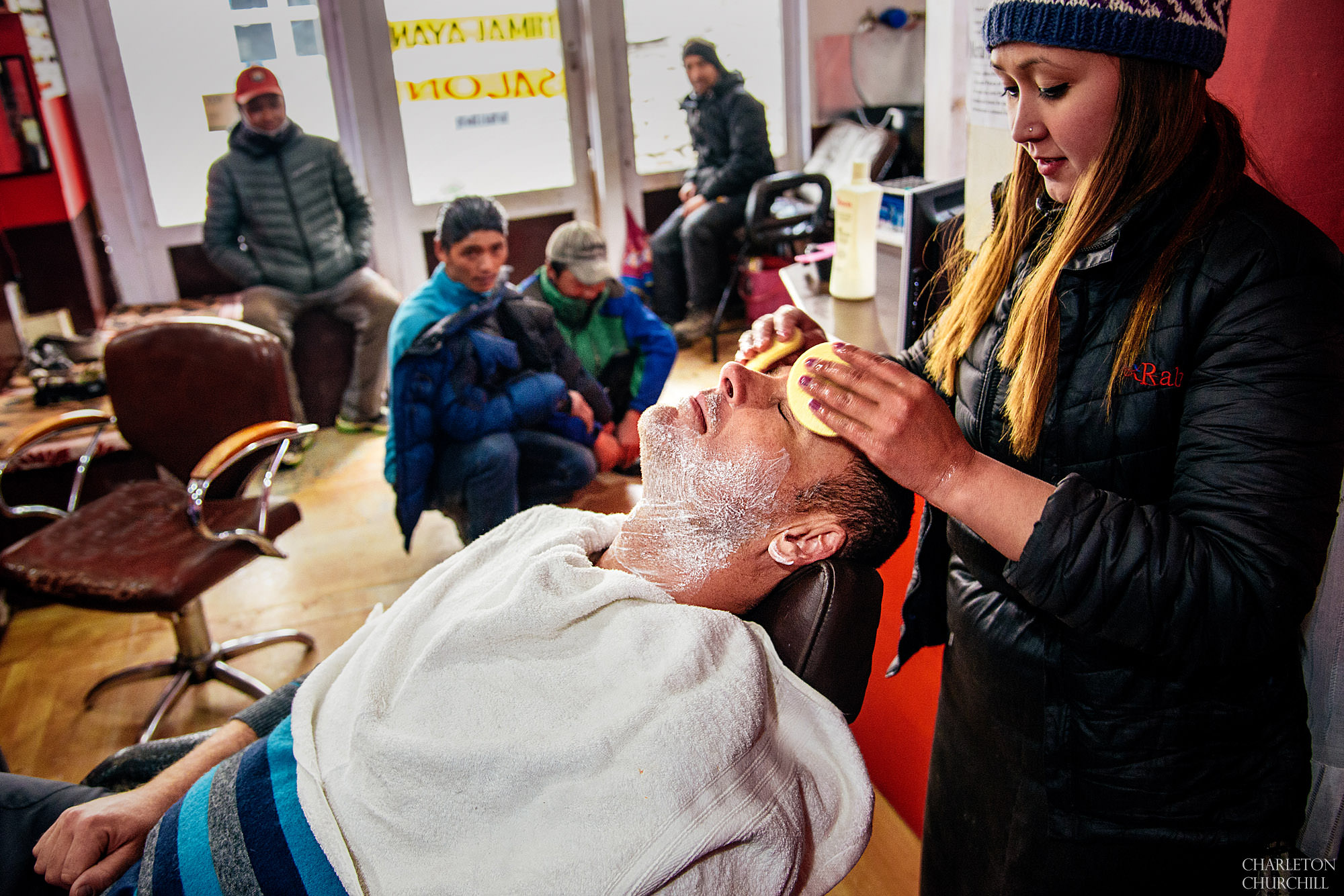 groom getting a shave at the local barber on everest namche bazar