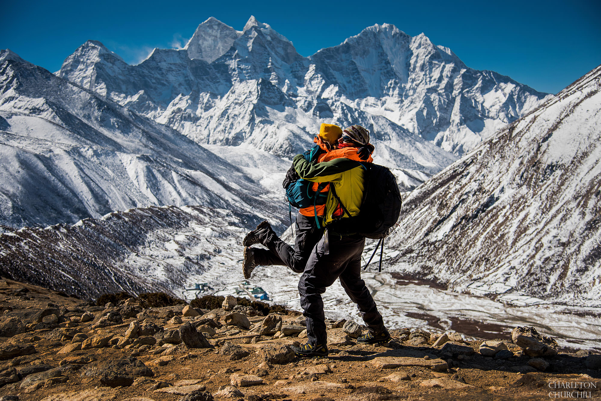 adventure wedding couple hiking through wilderness in the himalayas
