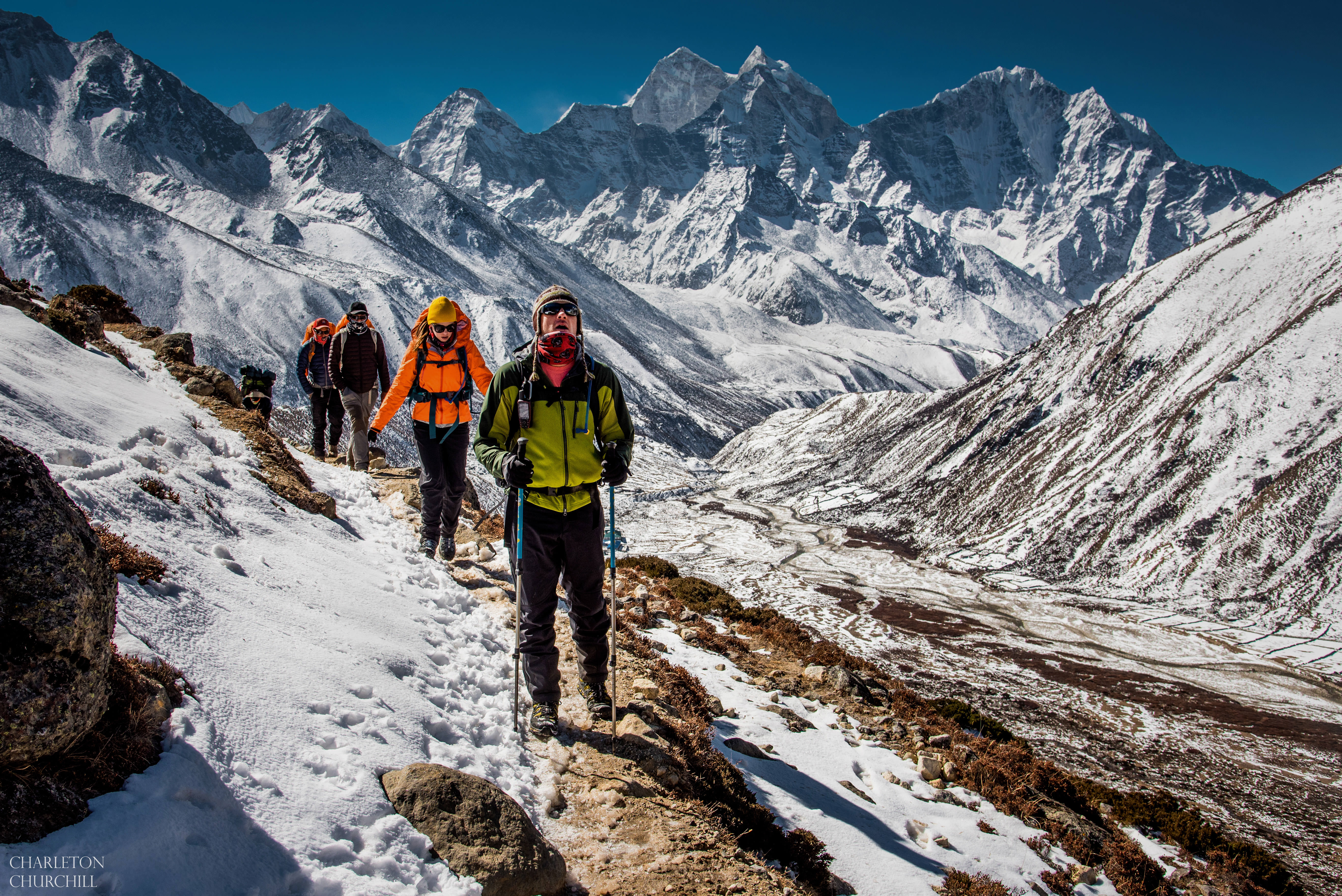 everest base camp trek photo with hikers trekking through the snow