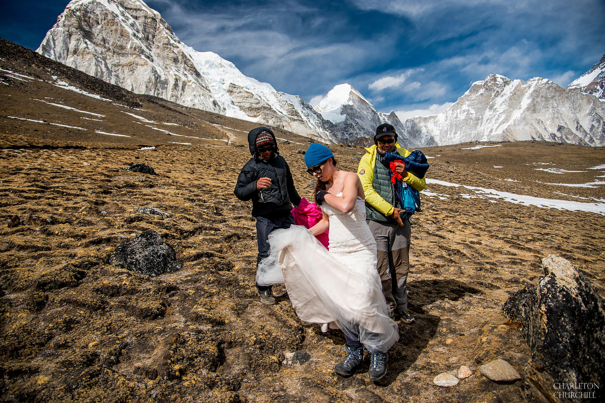 bride getting her dress on with sherpas helping at Kala pattar