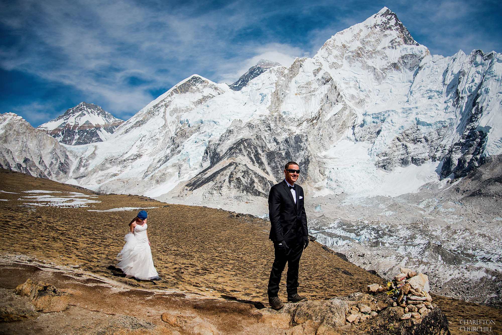 first look of the bride and groom on Mount Everest with mountains everywhere in the himalayas