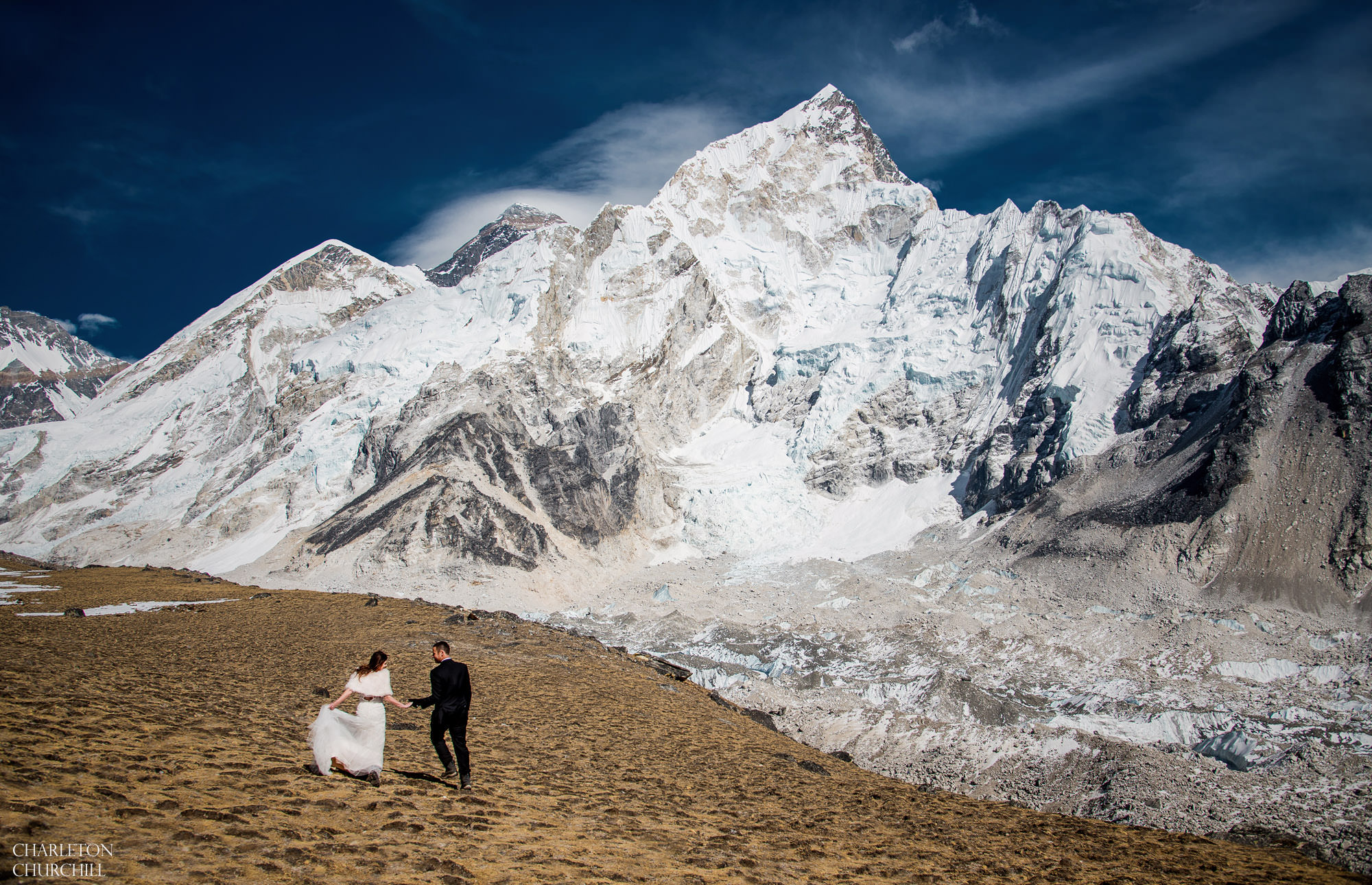from kala patar, wedding couple gets married with Mt. everest in the background and Nuptse face at 18,000 feet