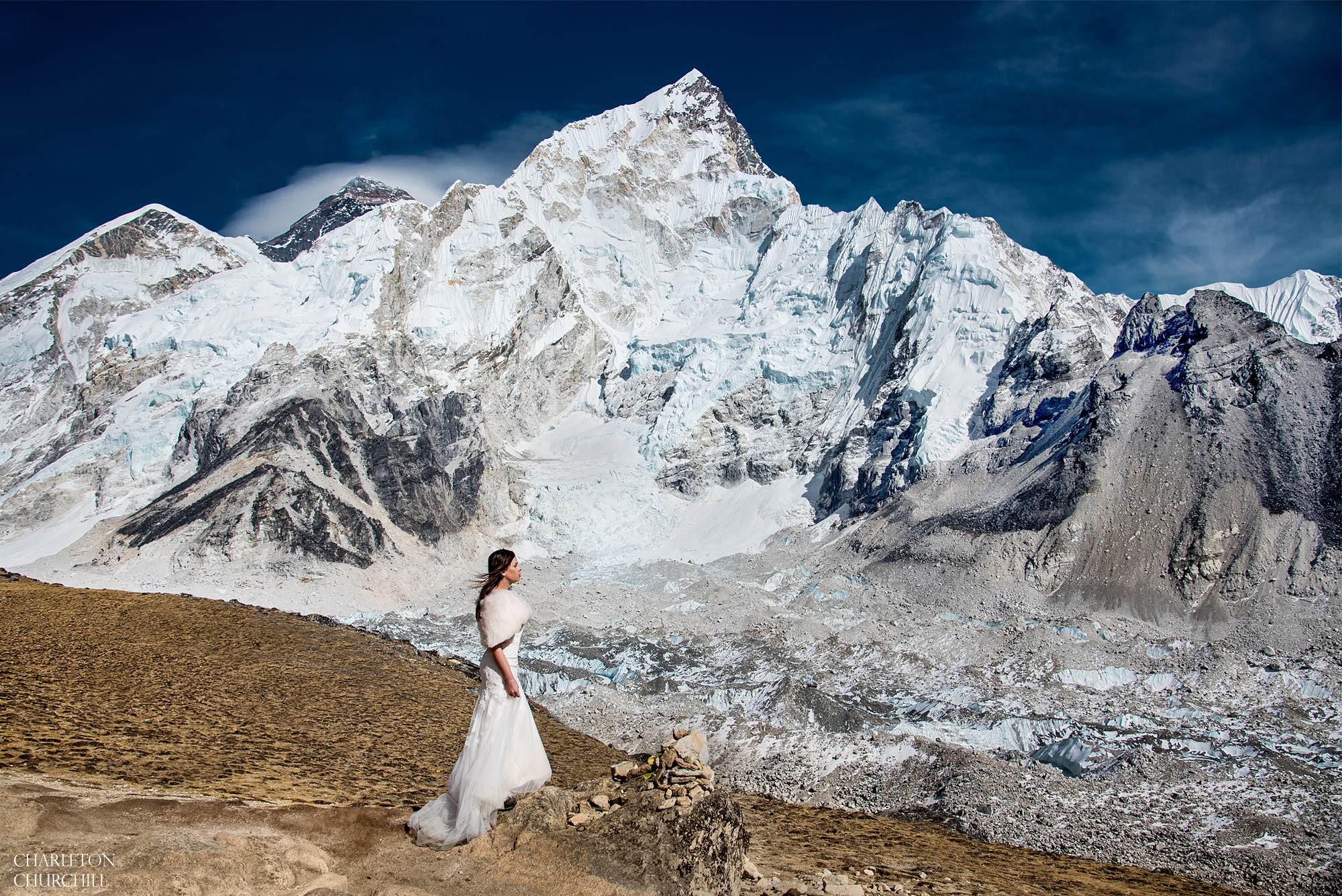 epic bridal portrait on Mt. Everest in her wedding dress and bride wrap in below freezing temperatures