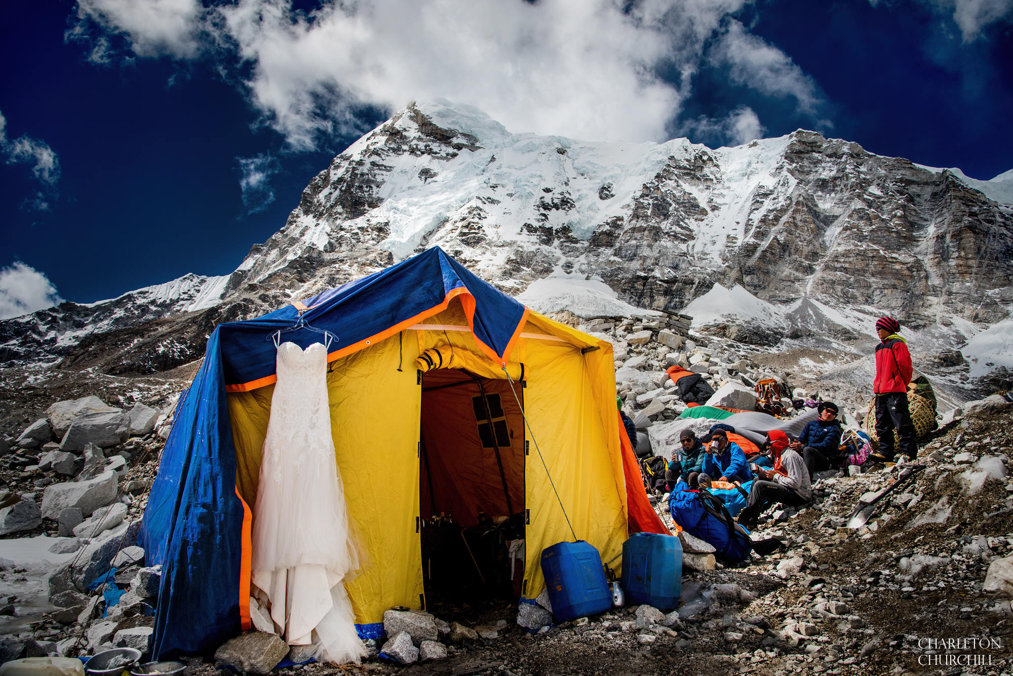 wedding dress at base camp mt. everest hanging on a tent