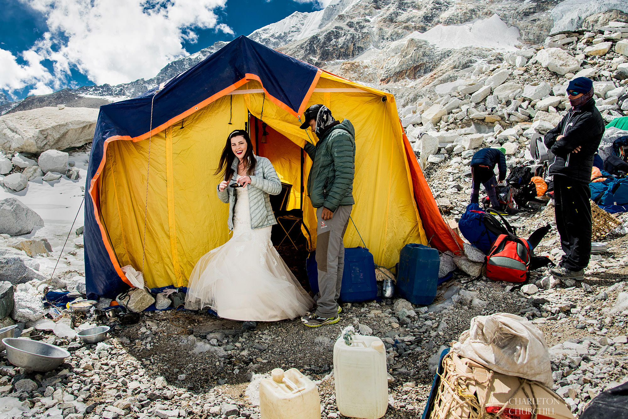 bride on mt. everest getting in her dress