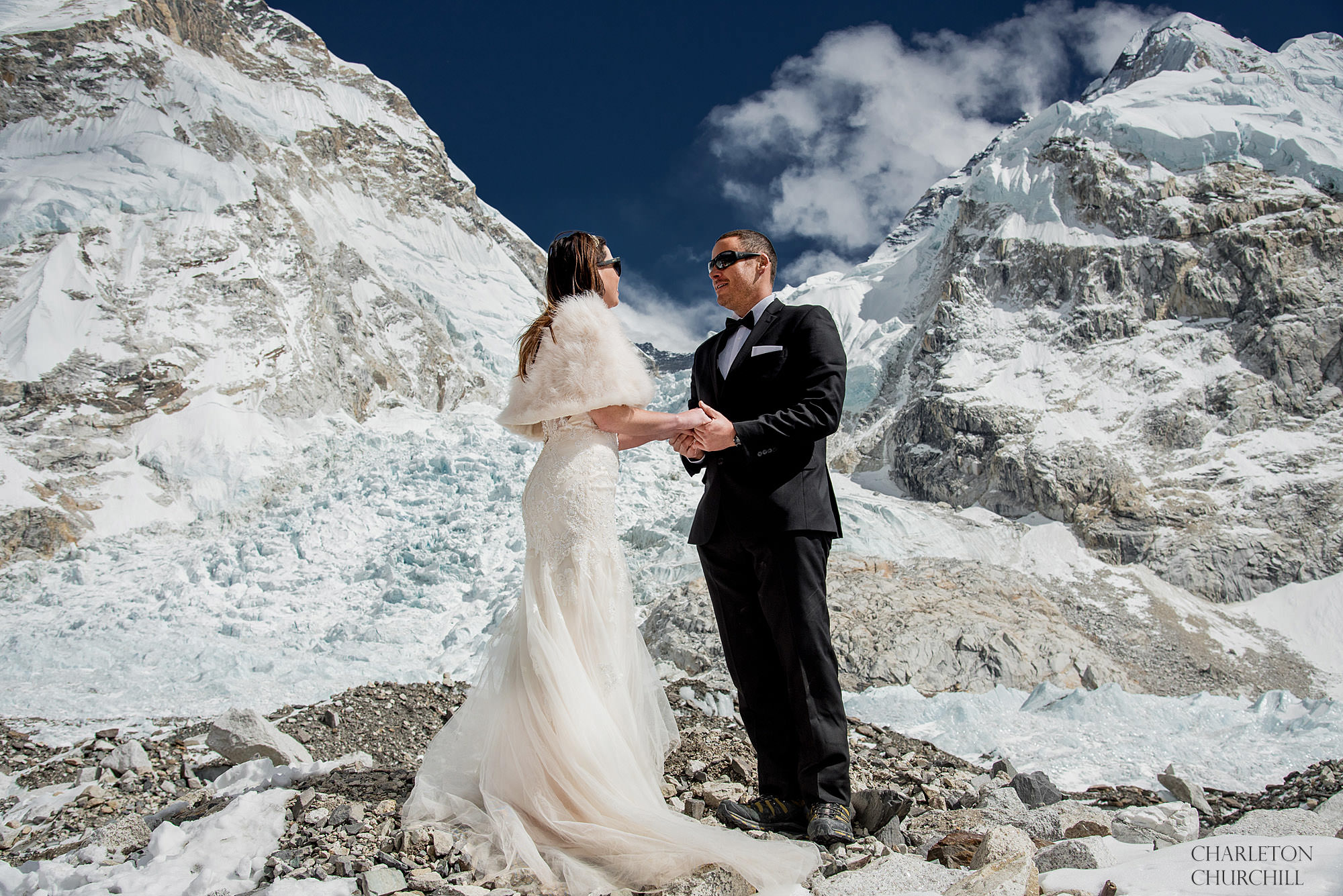 wedding ceremony at base camp of Mount Everest with a tuxedo and wedding dress and fur wrap