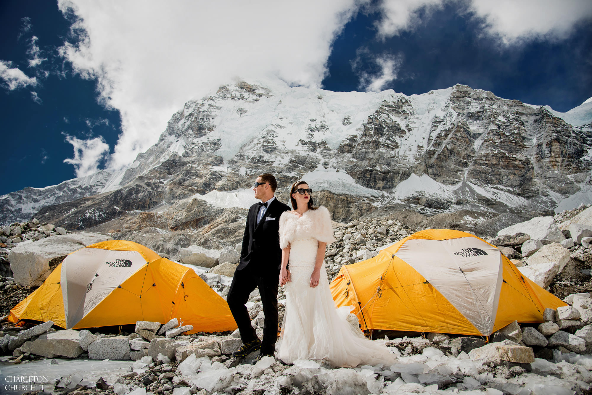 married in front of The North Face Everest tents at base camp, first couple with wedding dress