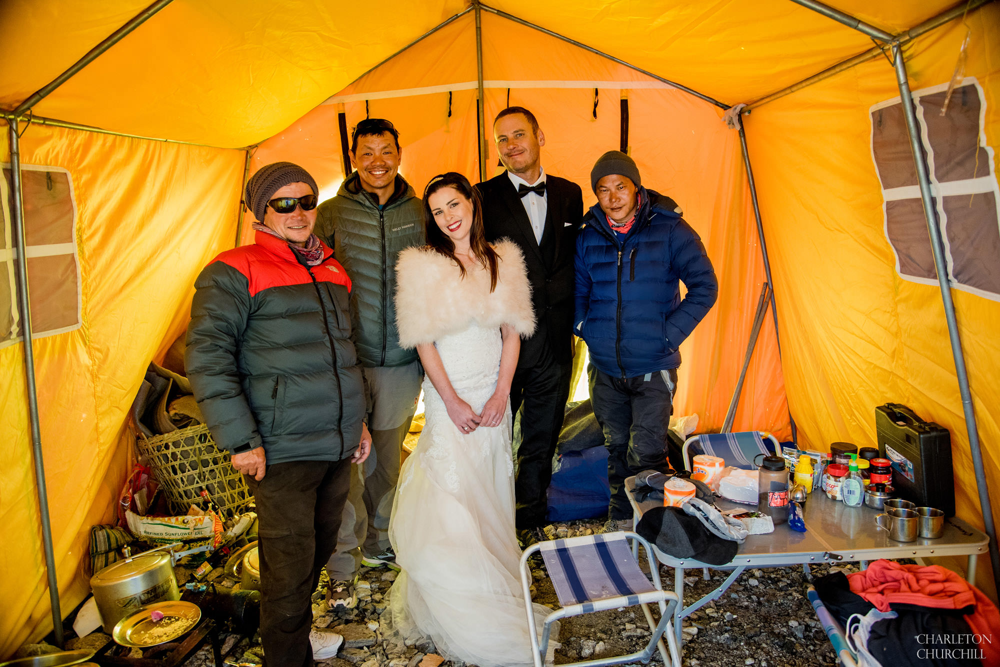 candid group shot of bride, groom, and sherpas, cook, and guide