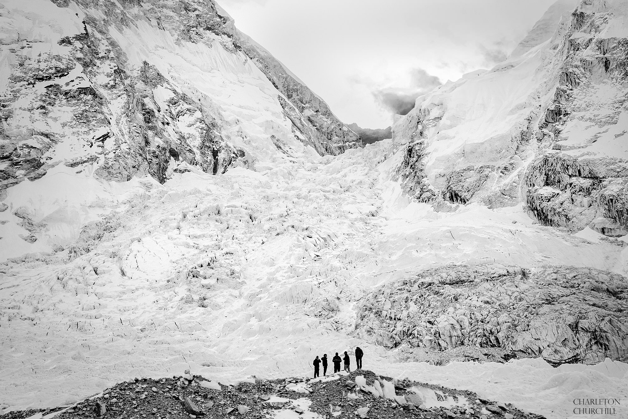 black and white photo of sherpas below khumbu ice-fall and Nuptse face