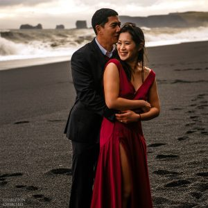 sunset photos of engaged couple in Iceland at beach with black sand called Reynisfjara