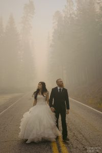 walking through the yosemite fire after wedding ceremony