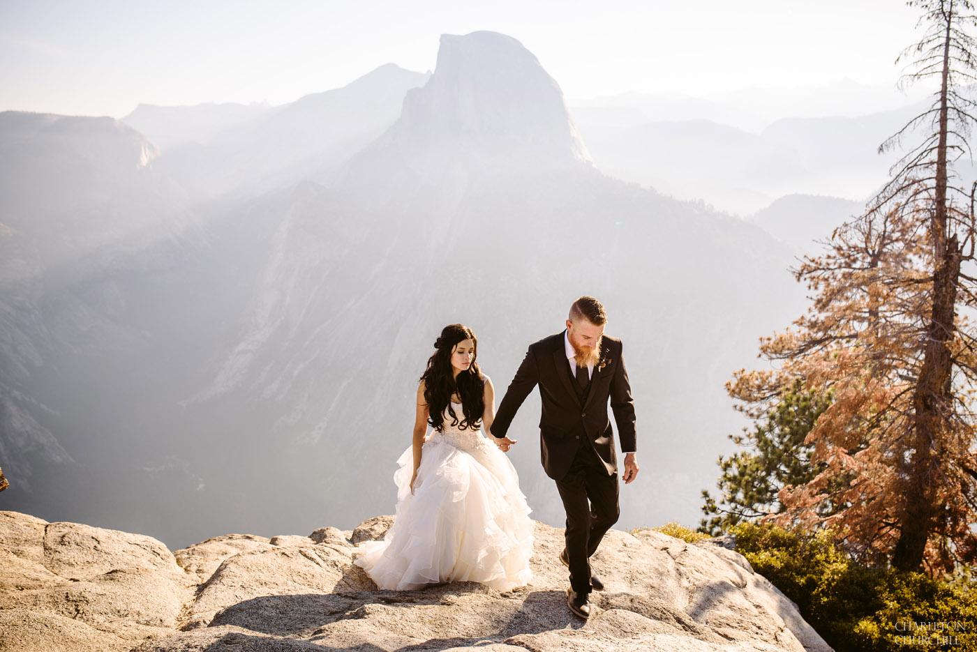 wedding walking photo on top of Yosemite point