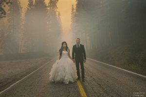 yosemite fire on glacier point road with wedding couple walking in the middle of smoke