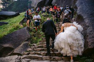 yosemite wedding couple hiking mist trail into vernal falls