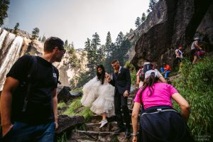 hikers and crowds with wedding couple in Yosemite
