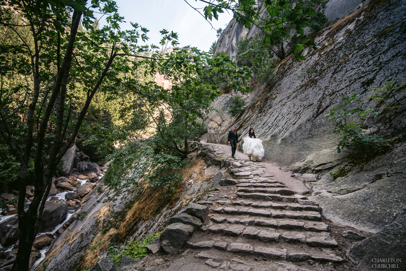 adventure wedding couple hiking the yosemite trails in suit and bridal gown