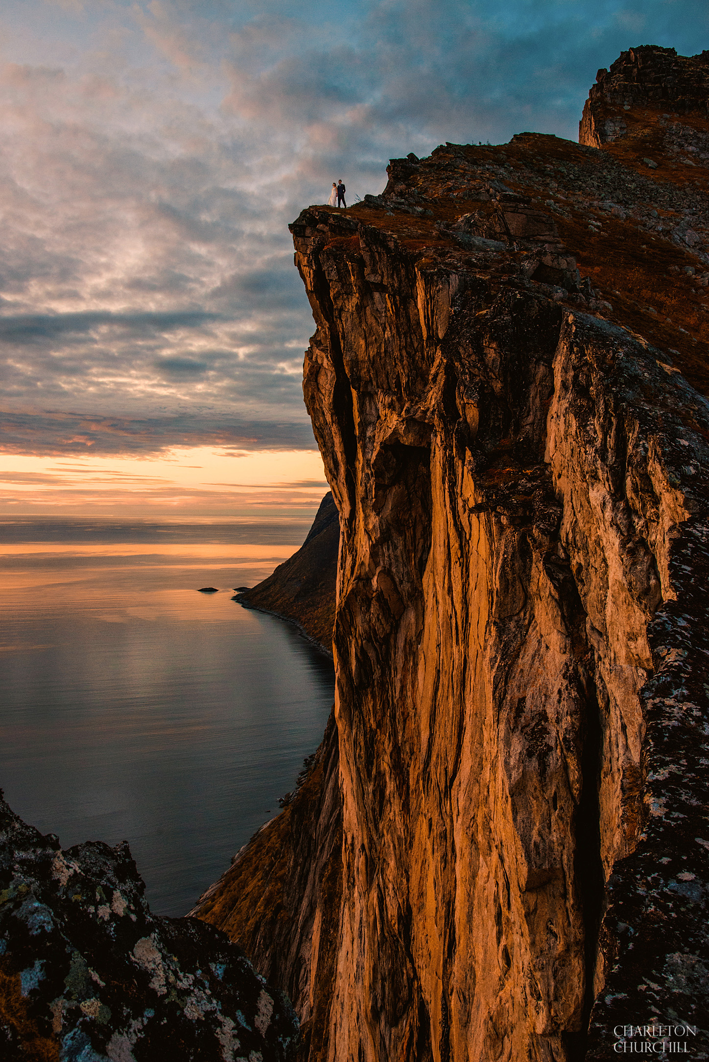 more epic wedding photos on cliff in senja norway