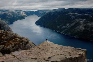 Preikestolen lysefjord wedding photography adventuring with bride and groom on a hike in the fall season
