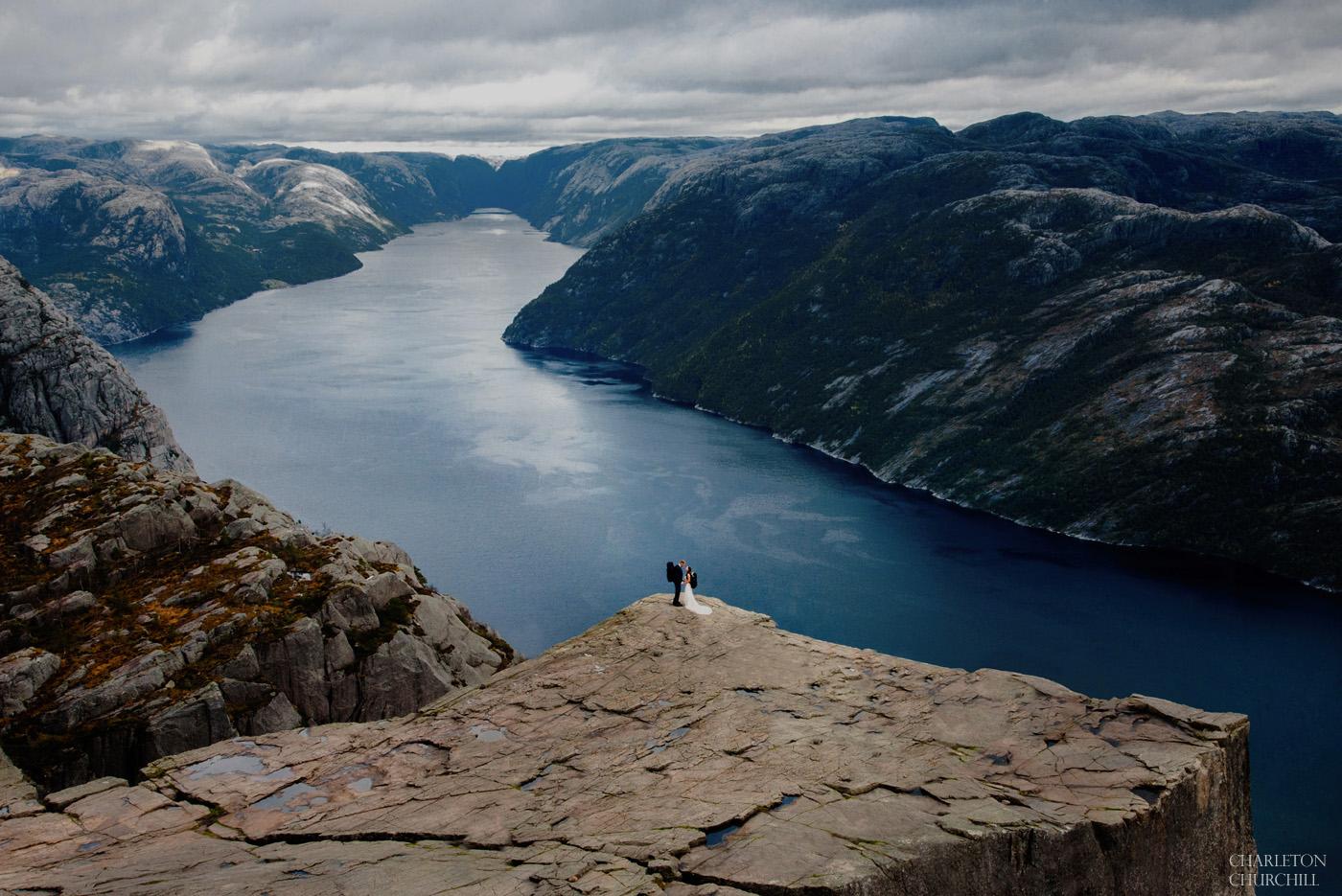 adventure wedding couple at Preikestolen lysefjord by elopement photographer charleton