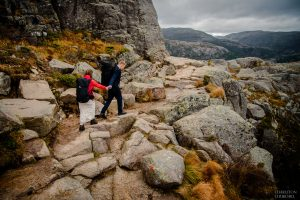 hiking with bride and groom on norway mountain in Lysefjord norway