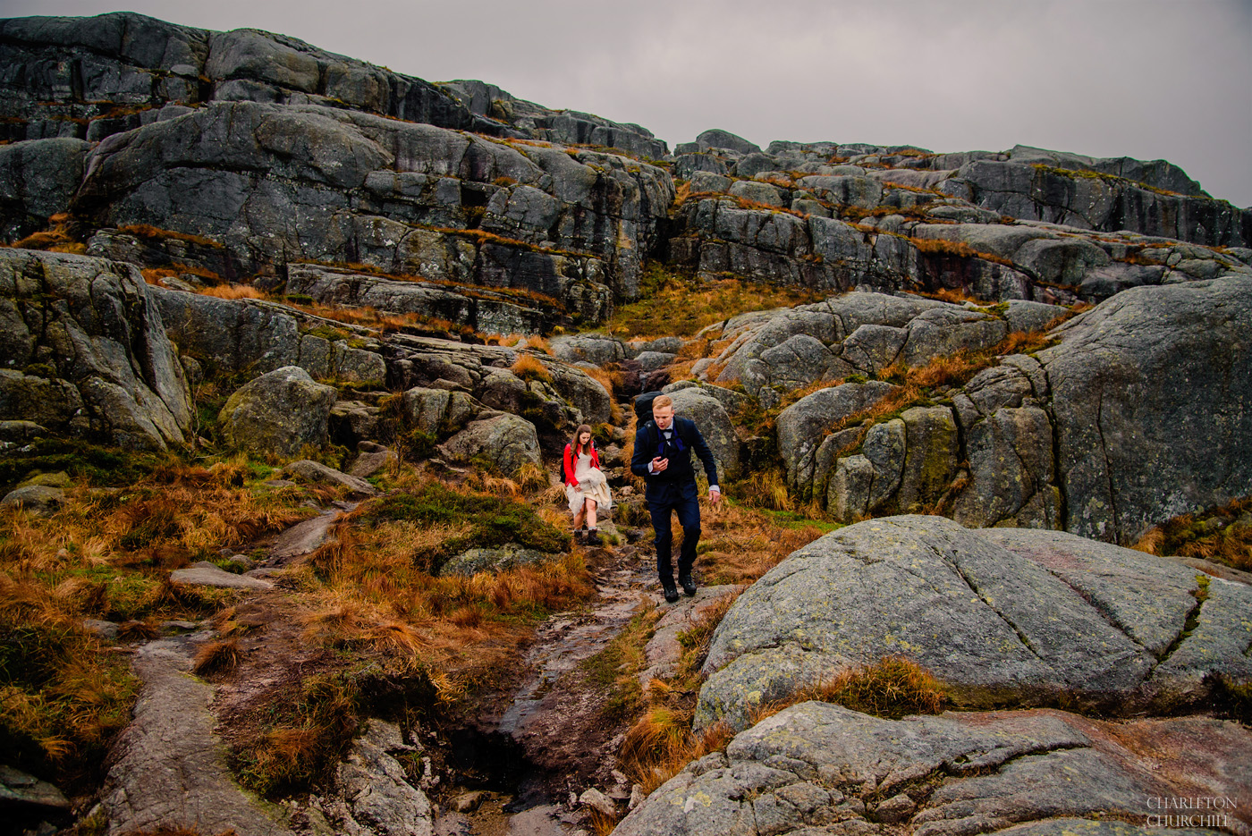 hiking Lysefjord with couple in the rain for their wedding photos