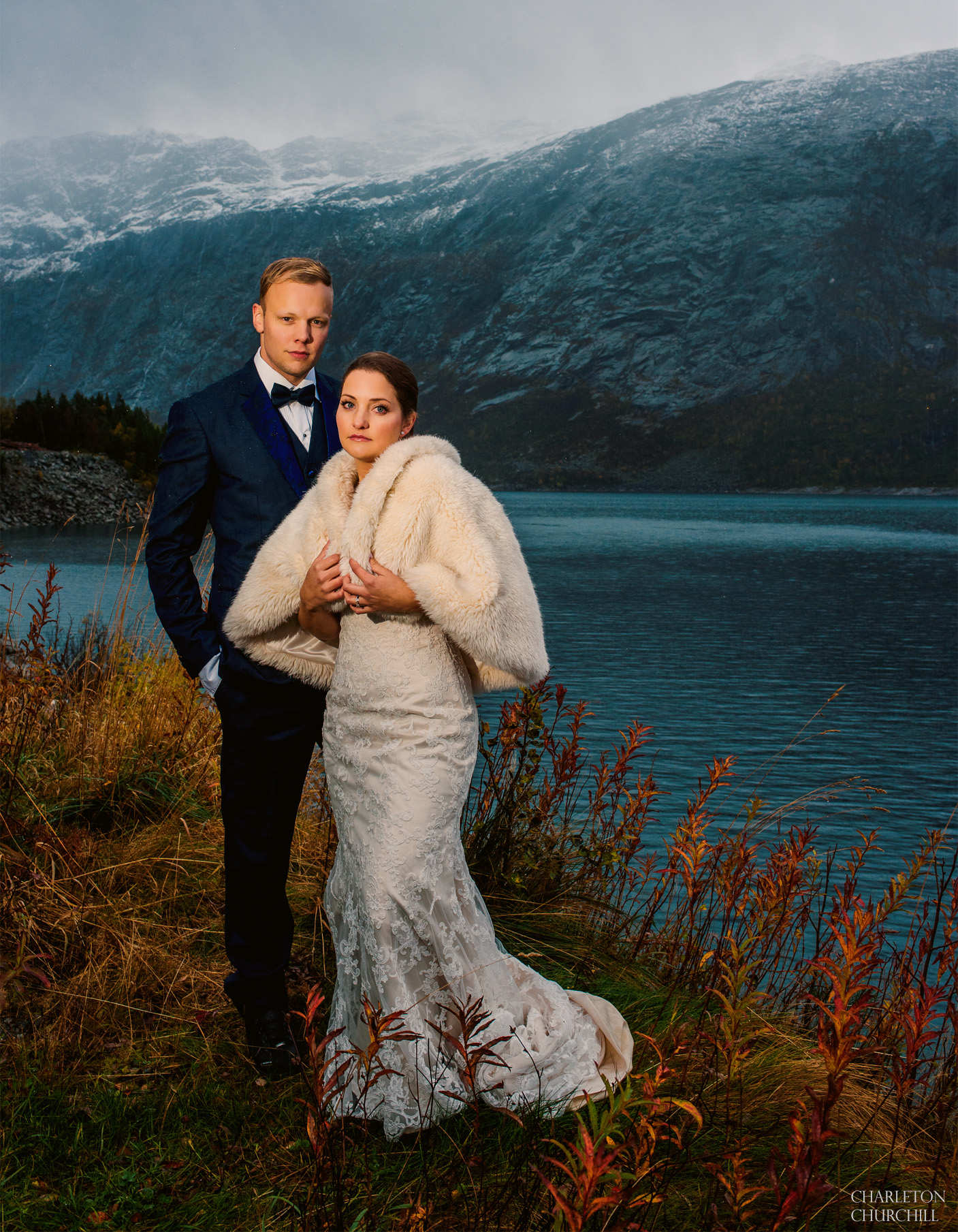 fall colors and rainy weather with a wedding couple, bride and groom in the rain in the fjords.