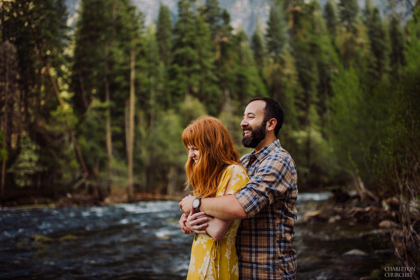 a couple laughing along Yosemite