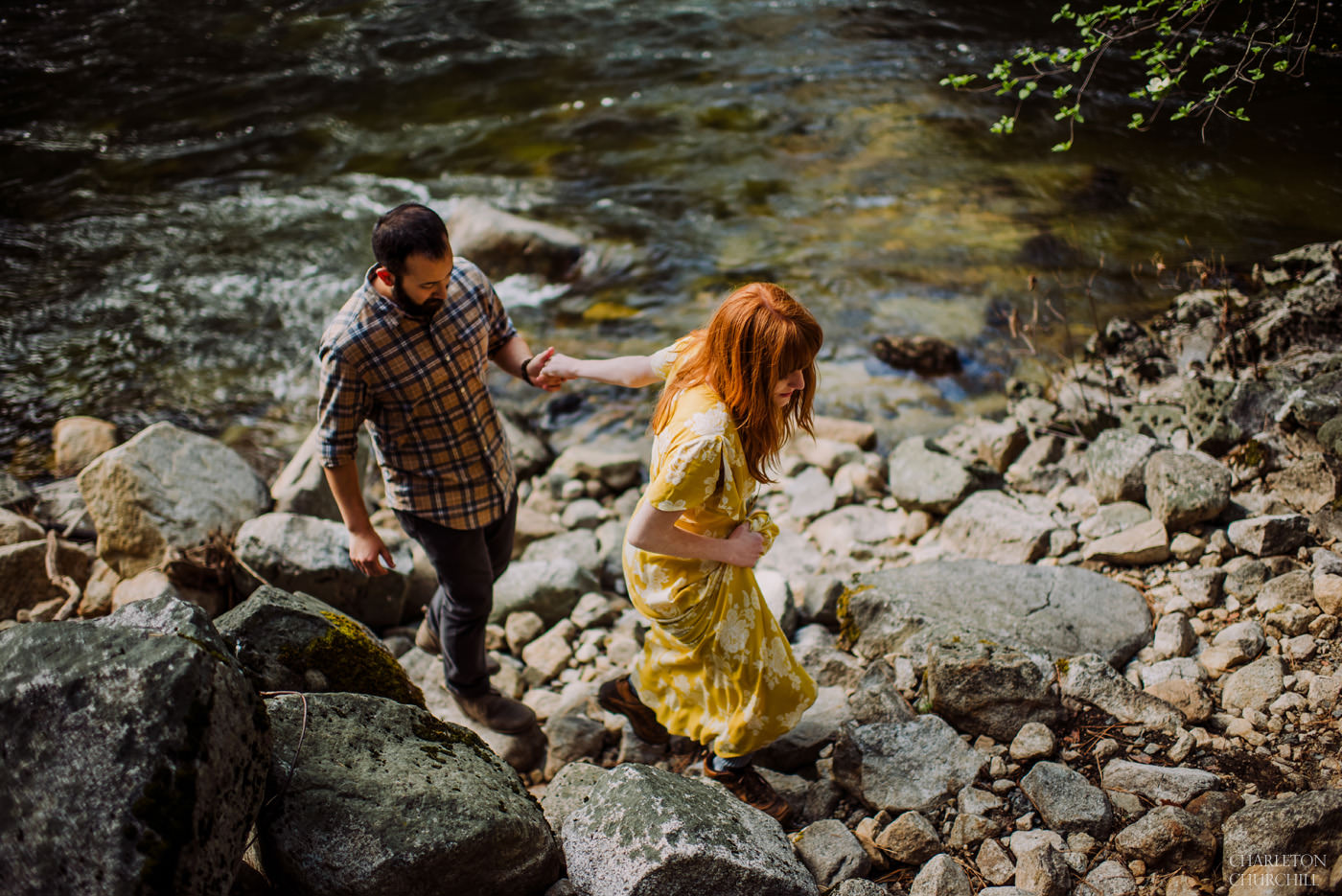 wedding couple hiking along river for their engagement images