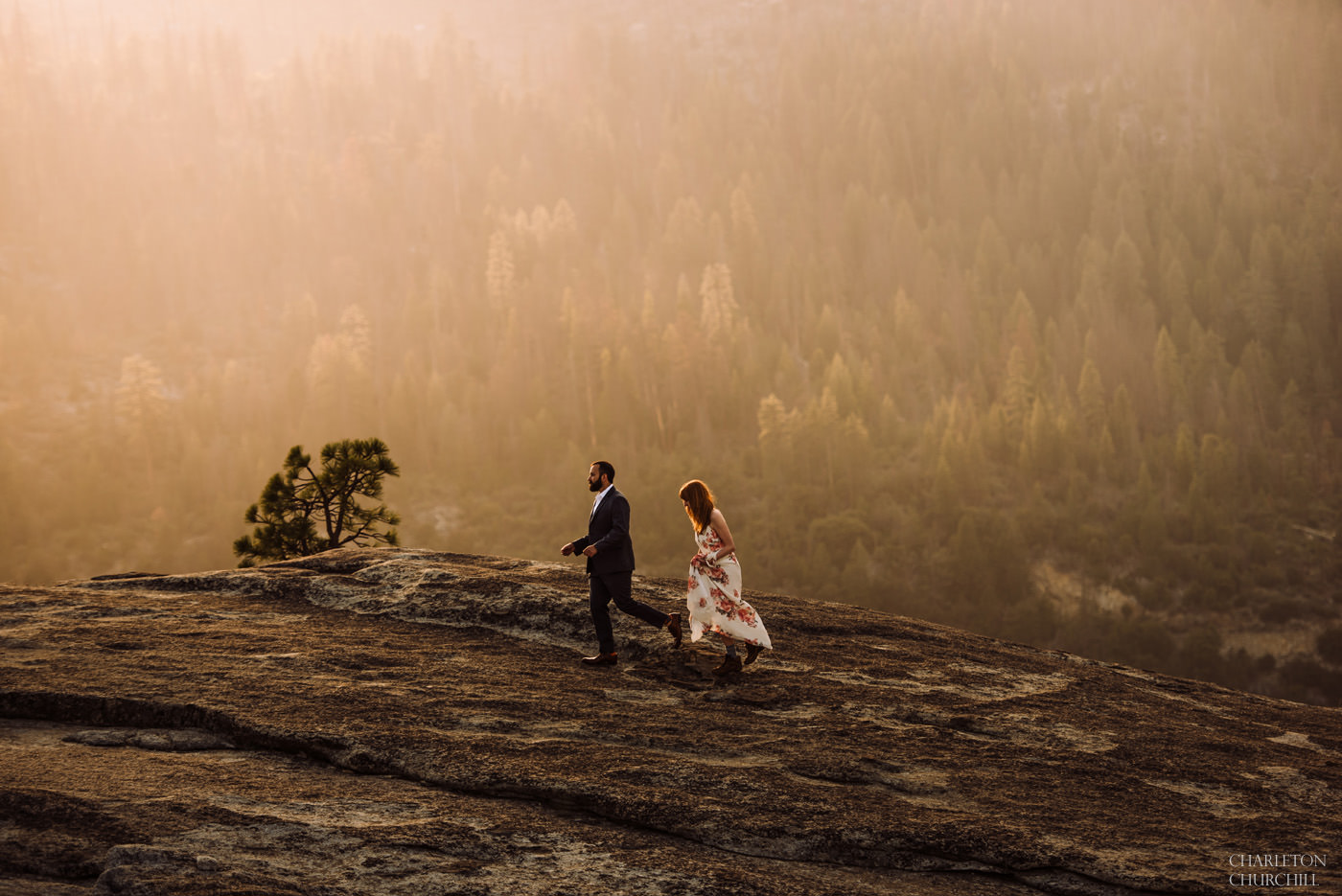 couple in natural light hiking for their engagement session out in the woods