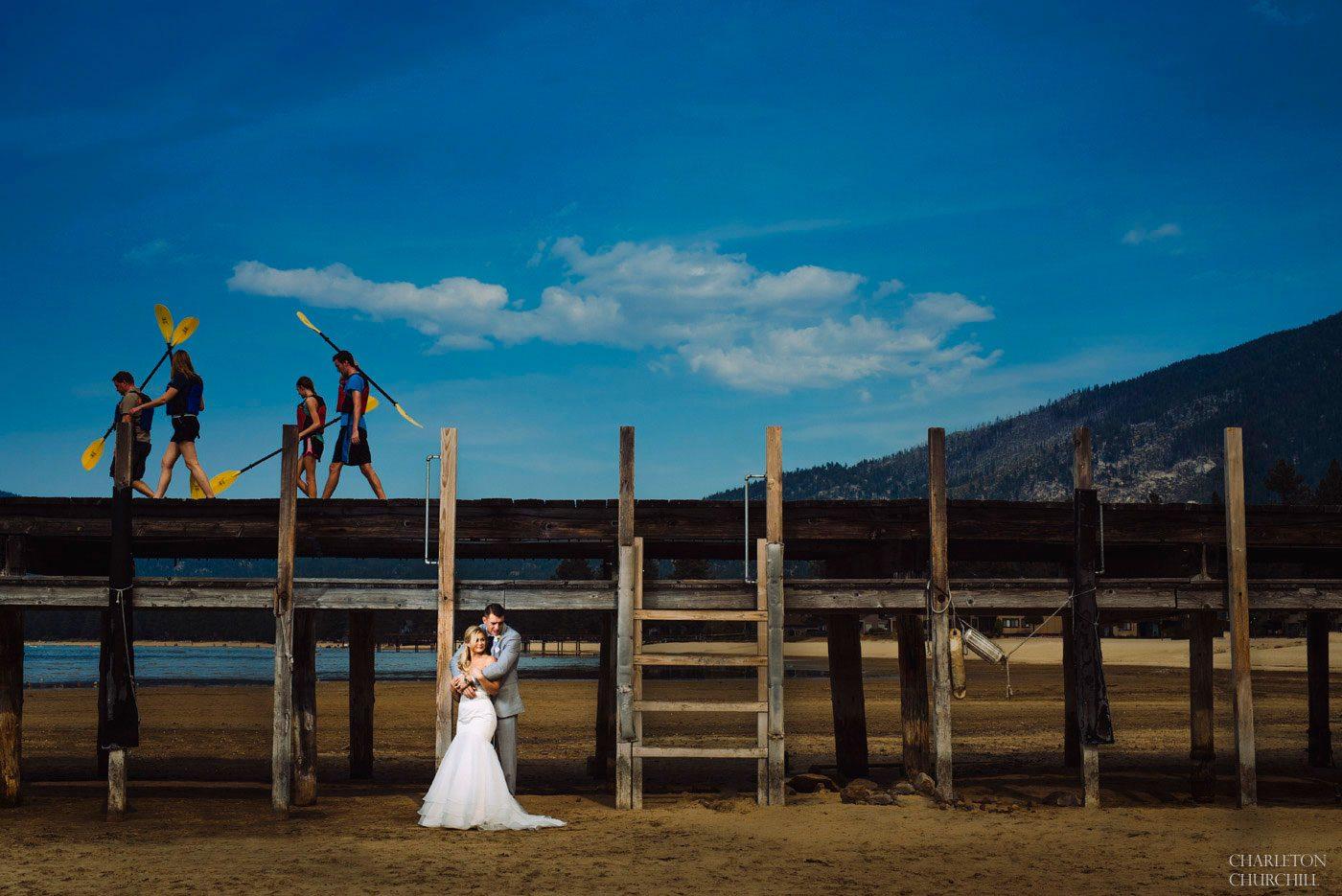 tahoe wedding photography of couple on dock overlooking the blue lake