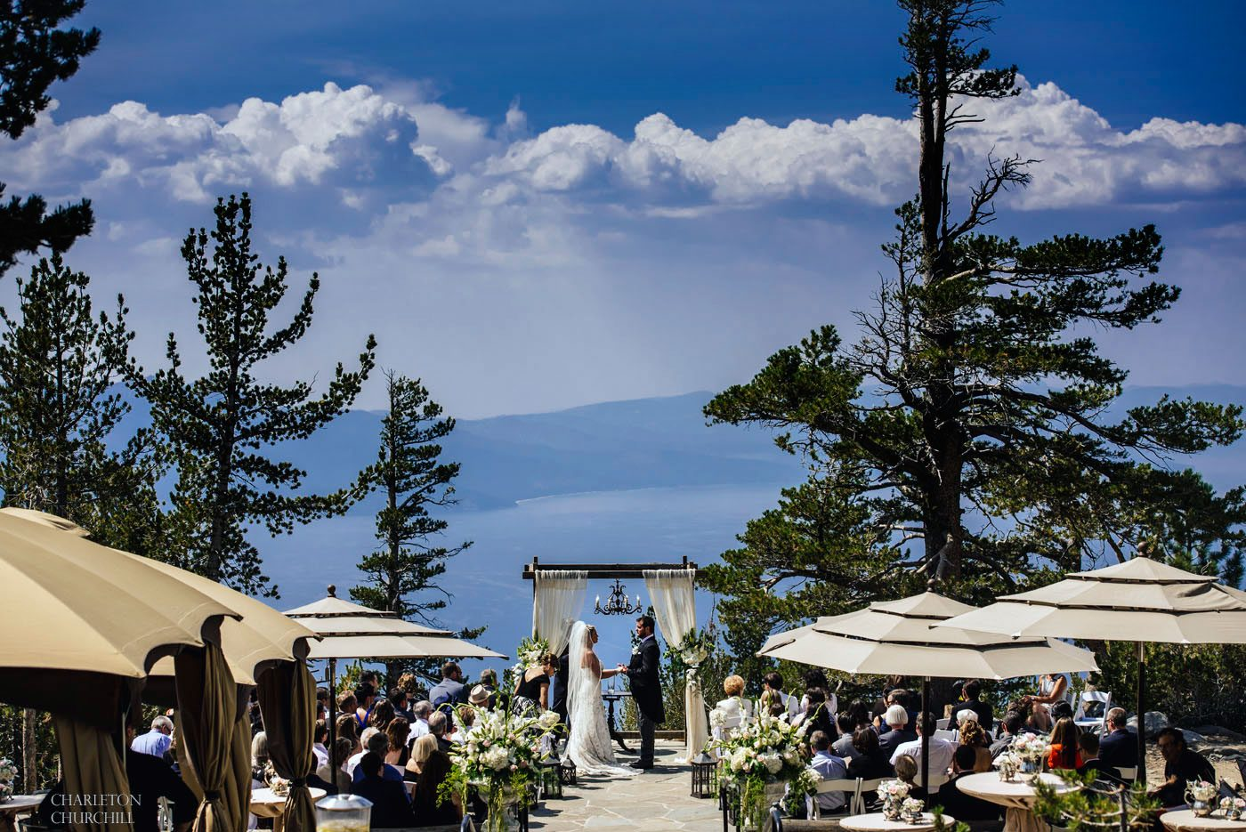 top of heavenly mountain for a wedding a couple shares vows to each other overlooking lake tahoe