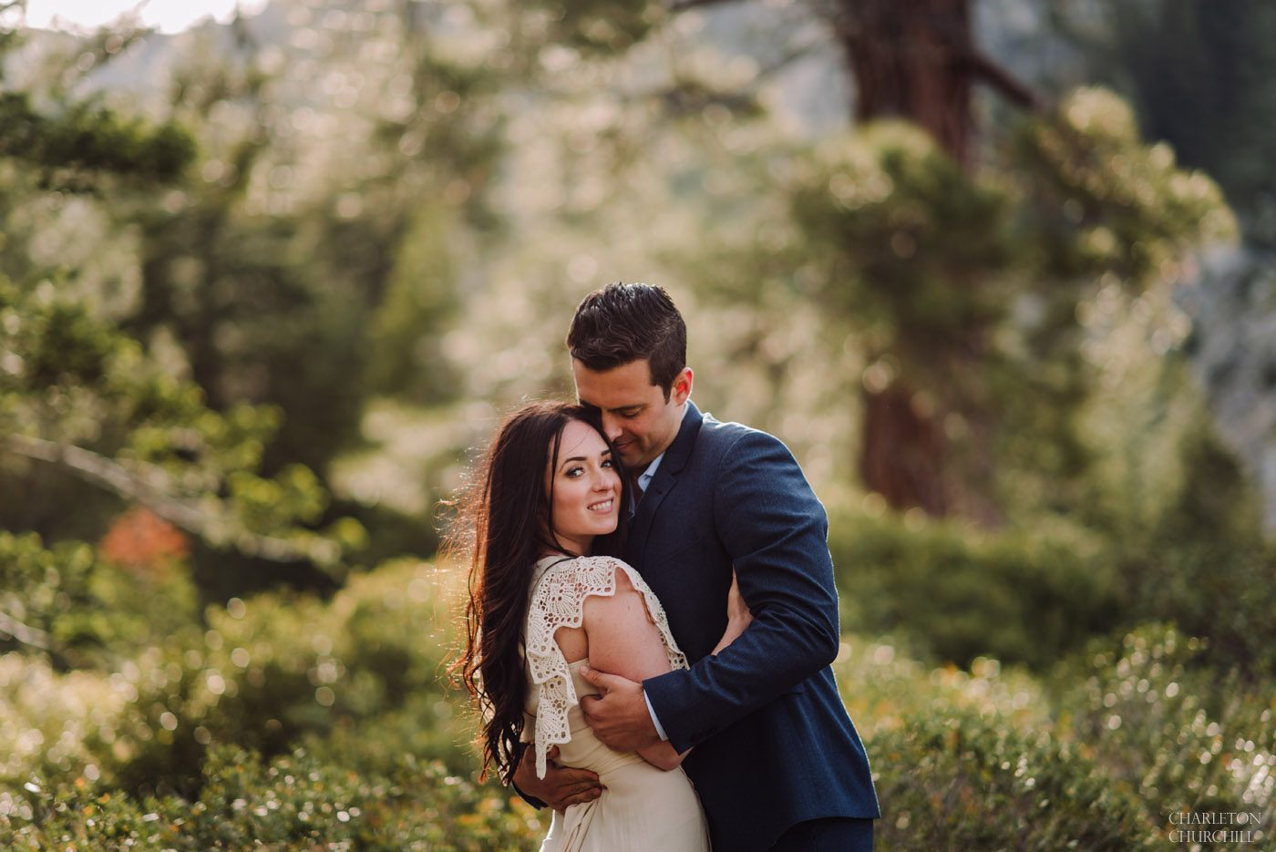beautiful natural light couples photos in the trees during sunset of Lake Tahoe