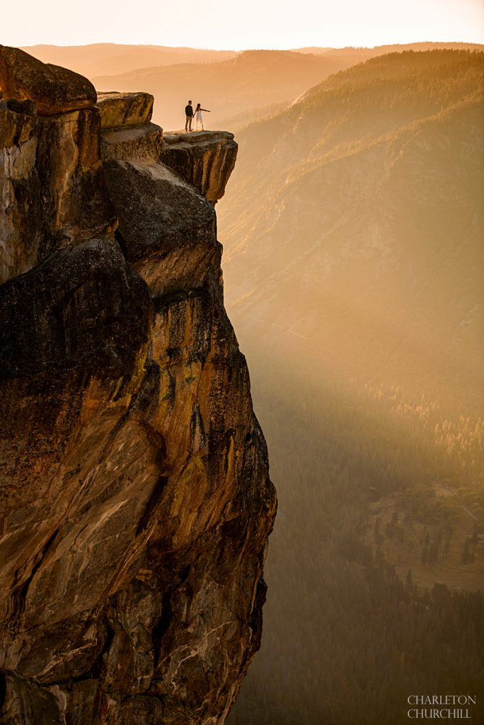 yosemite epic adventure wedding photos at sunset at taft point engaged couple