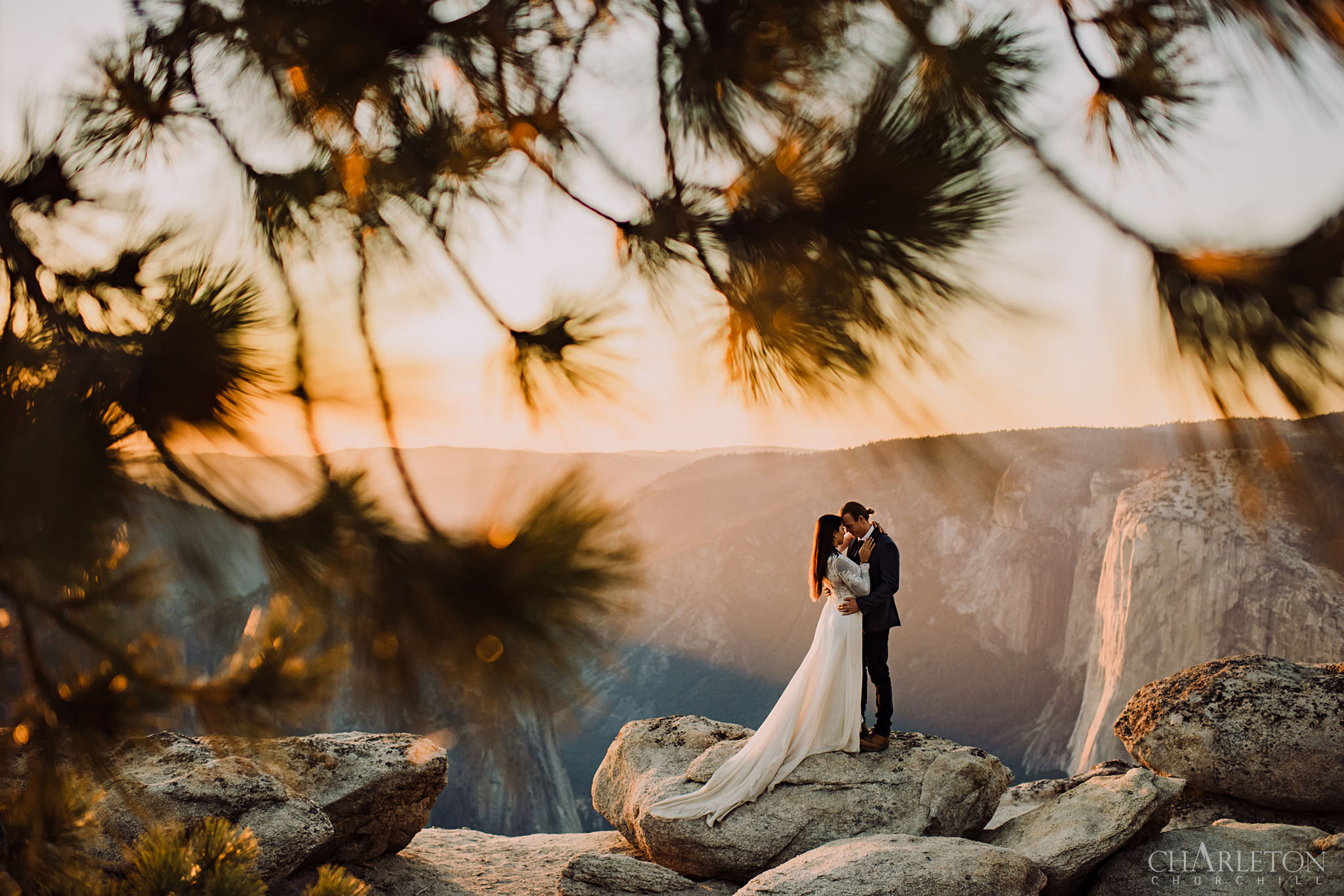Yosemite elopement of adventure couple at Taft Point over a cliff during sunset after their wedding ceremony
