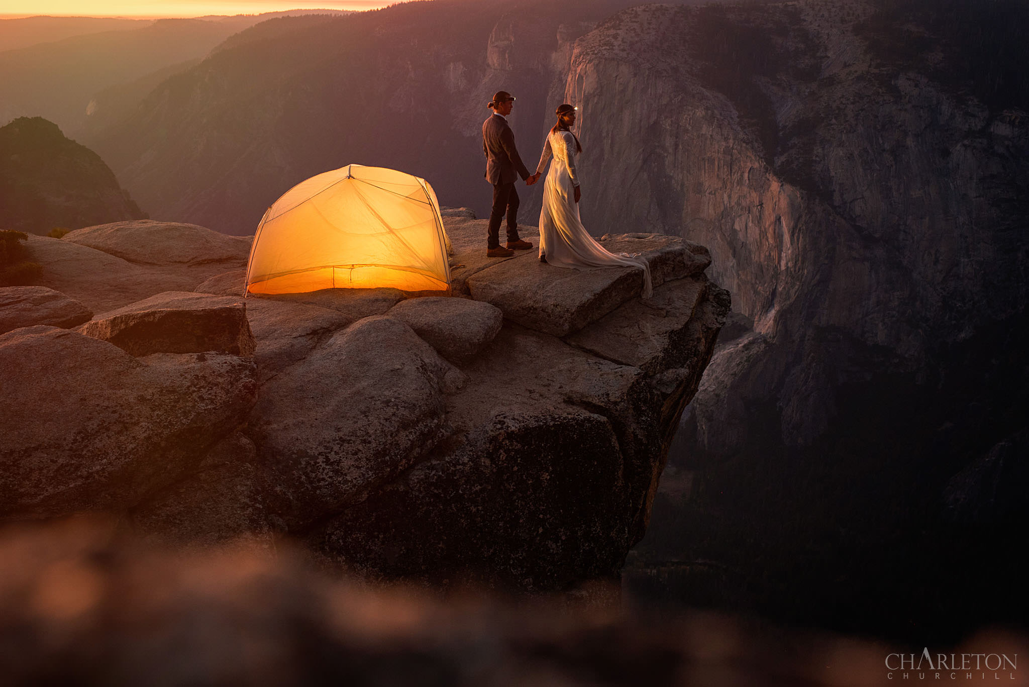 epic mountain couple wedding photos camping on ledge with headlamps at taft point yosemite photographed by Yosemite wedding photographer Charleton Churchill
